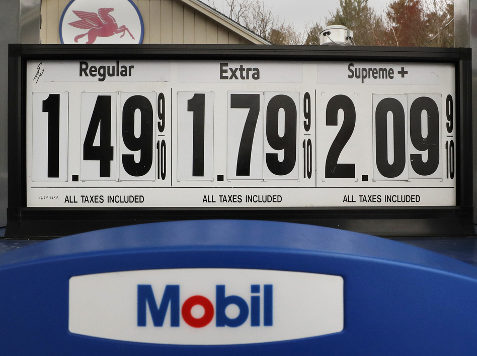 Gasoline prices are posted at a Mobil gas station in Candia, N.H., on April 30. The coronavirus pandemic has renewed a critical debate about just when global oil demand will peak. (Charles Krupa/AP)