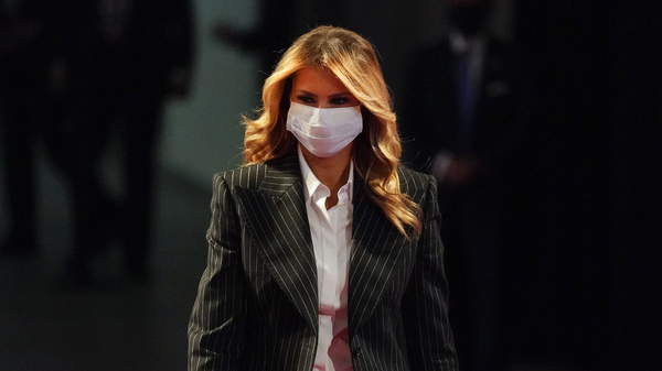 First lady Melania Trump, pictured wearing a face mask at the presidential debate on Sept. 29, said she and the Trumps