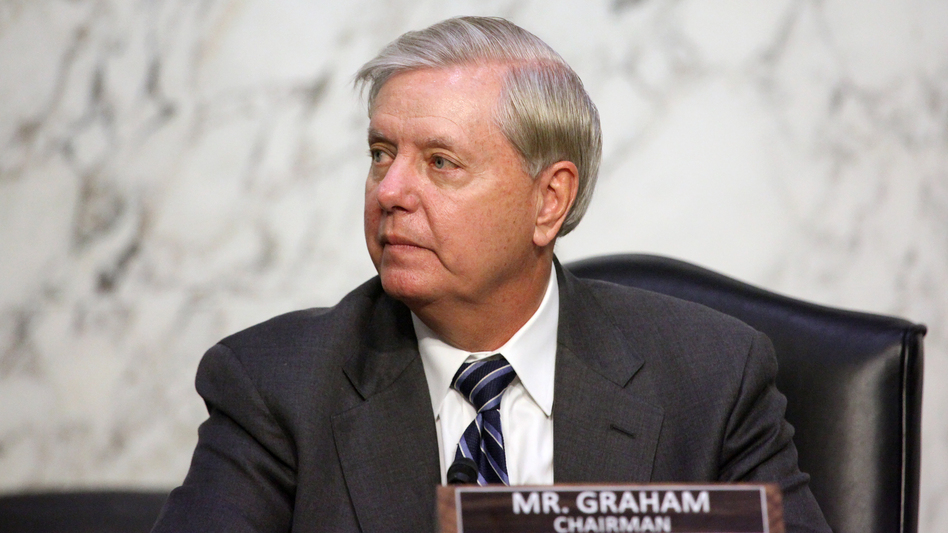 Sen. Lindsey Graham, R-S.C., looks on as Supreme Court nominee Judge Amy Coney Barrett testifies before the Senate Judiciary Committee on the third day of her confirmation hearing. (Pool/Getty Images)