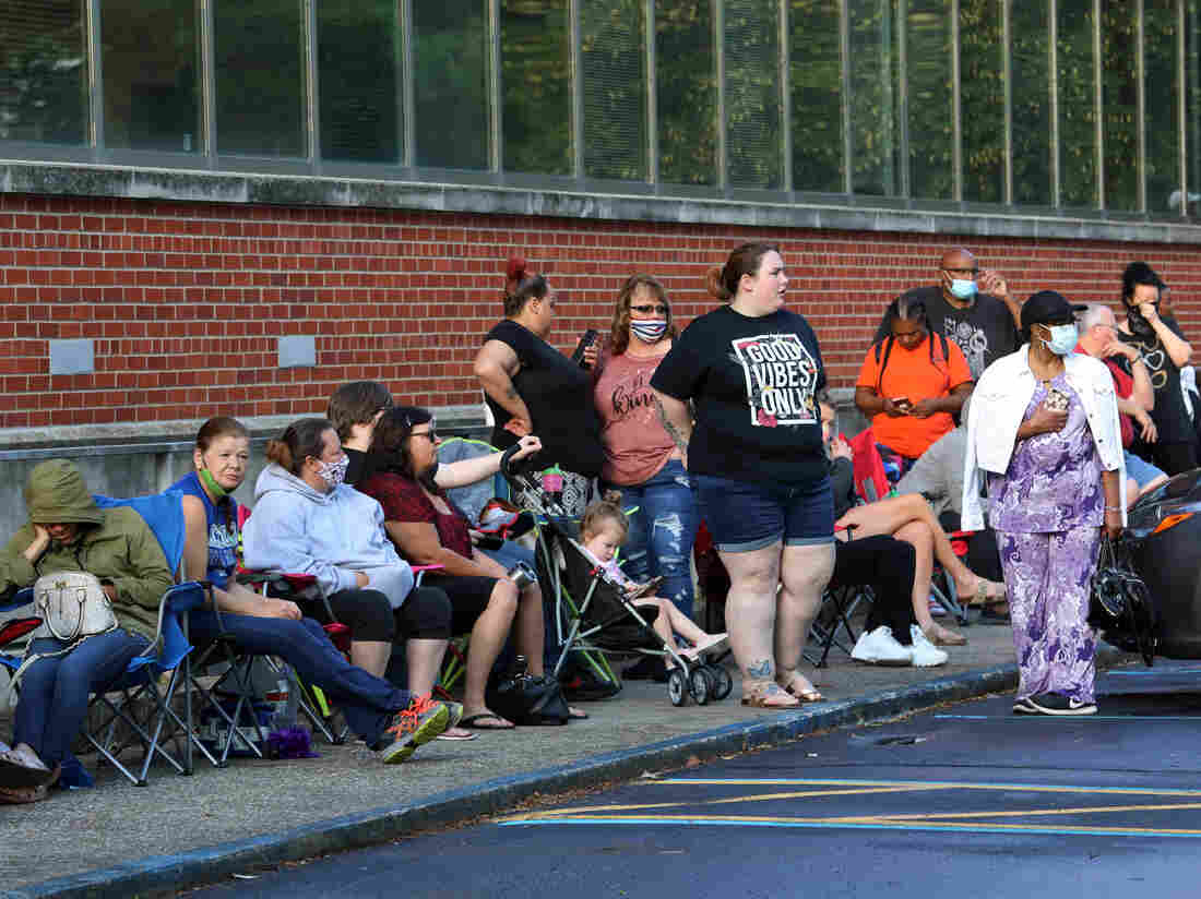 FRANKFORT, KY - JUNE 19: Hundreds of unemployed Kentucky residents wait in long lines outside the Kentucky Career Center for help with their unemployment claims on June 19, 2020 in Frankfort, Kentucky. (Photo by John Sommers II/Getty Images)