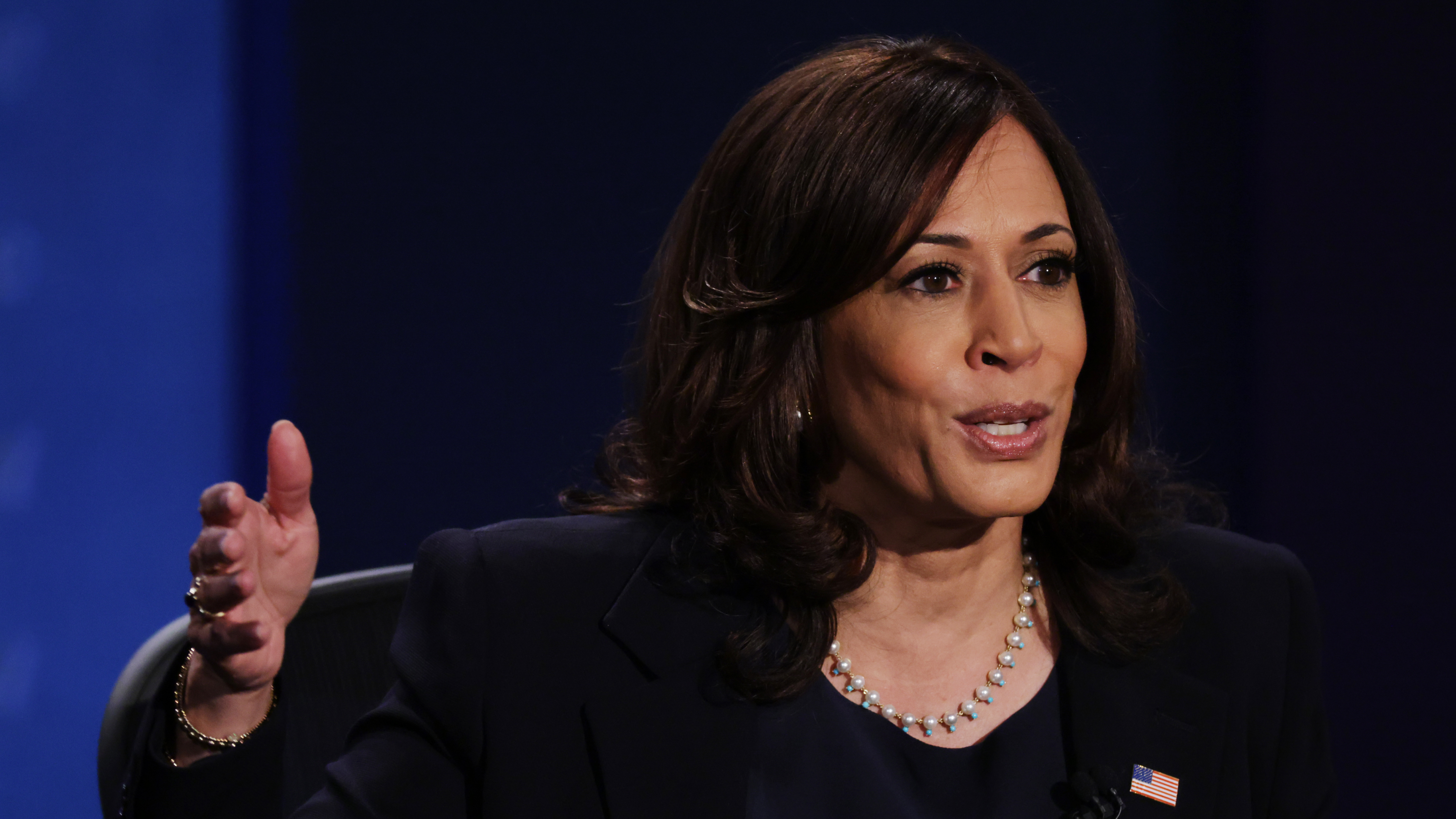 Democratic vice presidential nominee and California Sen. Kamala Harris, seen here during the Oct. 7 vice presidential debate, is postponing in-person campaign events after two people traveling with her tested positive for the coronavirus.