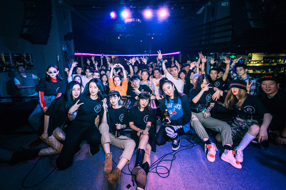 Members of the Bad Girls rap group, which was started by Deng Ge, pose with audience members at a pre-pandemic hip-hop party. Now that the coronavirus is under control in Wuhan, audiences are once again gathering for concerts.