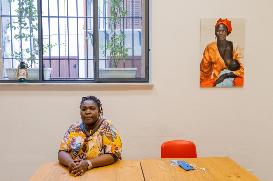 Osas Egbon, co-founder of a group that helps women who've been trafficked for sex work, at a cafe in Palermo where she meets with women she's seeking to help.