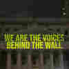 'The Writing On The Wall' Finds Poetry Behind Bars, Projects It Onto Buildings