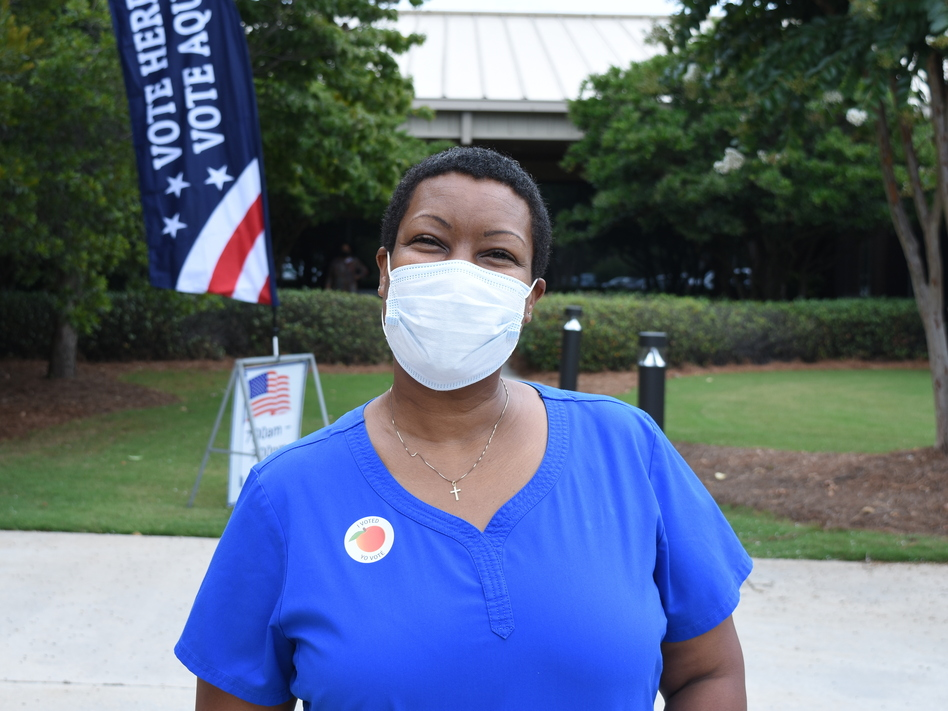 Angela Maddox didn't have to wait to vote in a primary runoff in August in Gwinnett County. She says reports of voters waiting six hours or more in the primary were