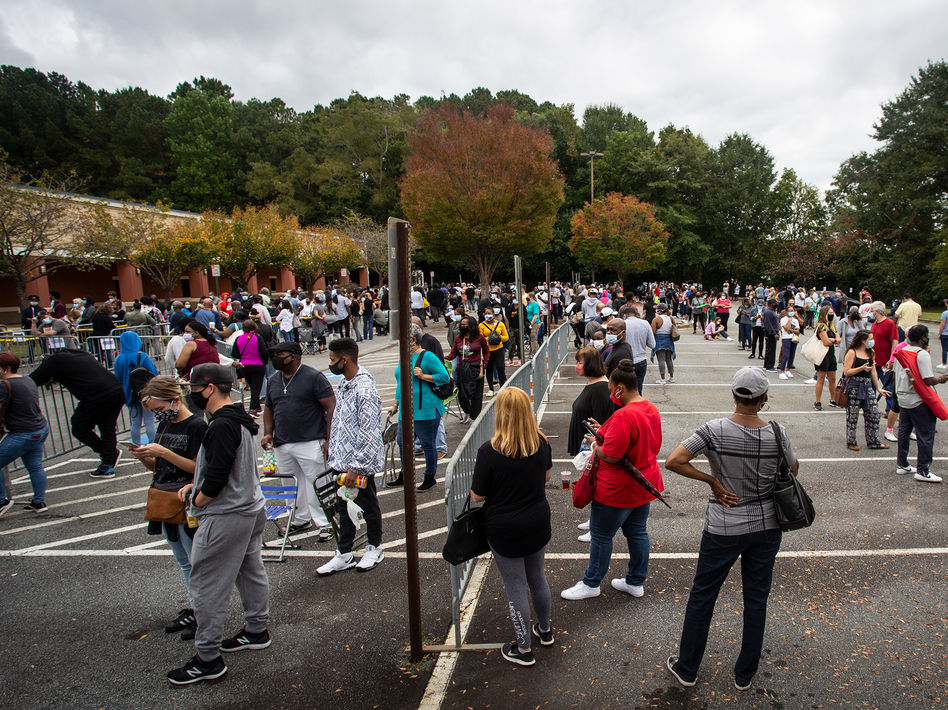 Hundreds of people wait in line for early voting earlier this week in Marietta, Ga. Eager voters have waited six hours or more in the former Republican stronghold of Cobb County, and lines have wrapped around buildings in solidly Democratic DeKalb County.