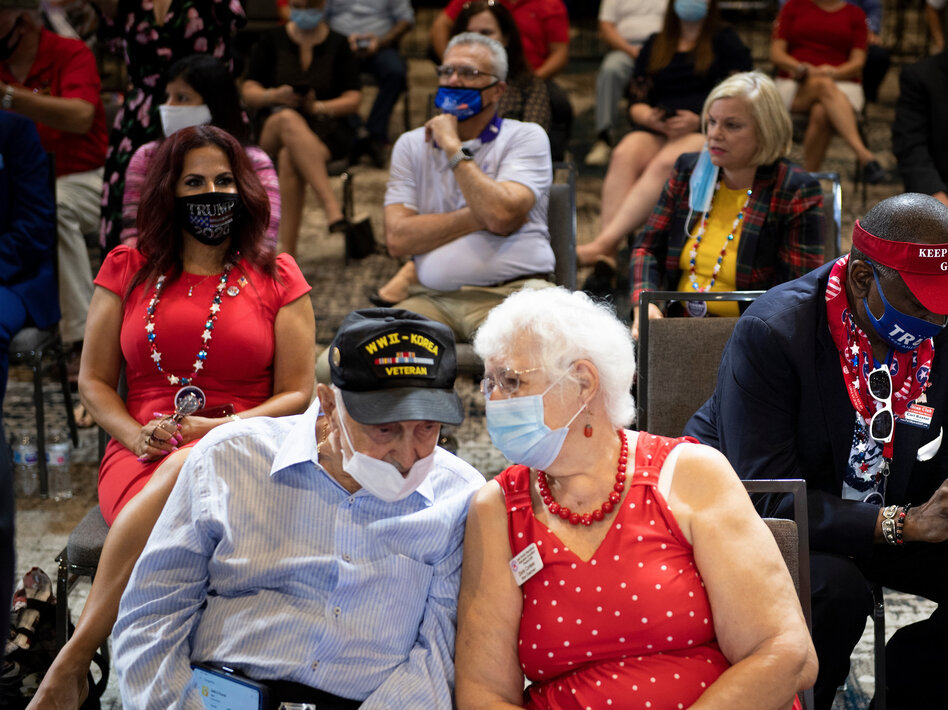 Supporters wait for President Trump to speak on Friday at an event geared toward seniors. A recent survey by seniors' group AARP shows Trump and Joe Biden virtually tied among seniors.