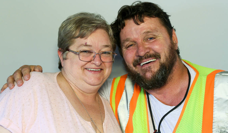 Brian McConnell, right, spoke with his wife, Nora, during a StoryCorps interview in Atlanta in 2016, about his