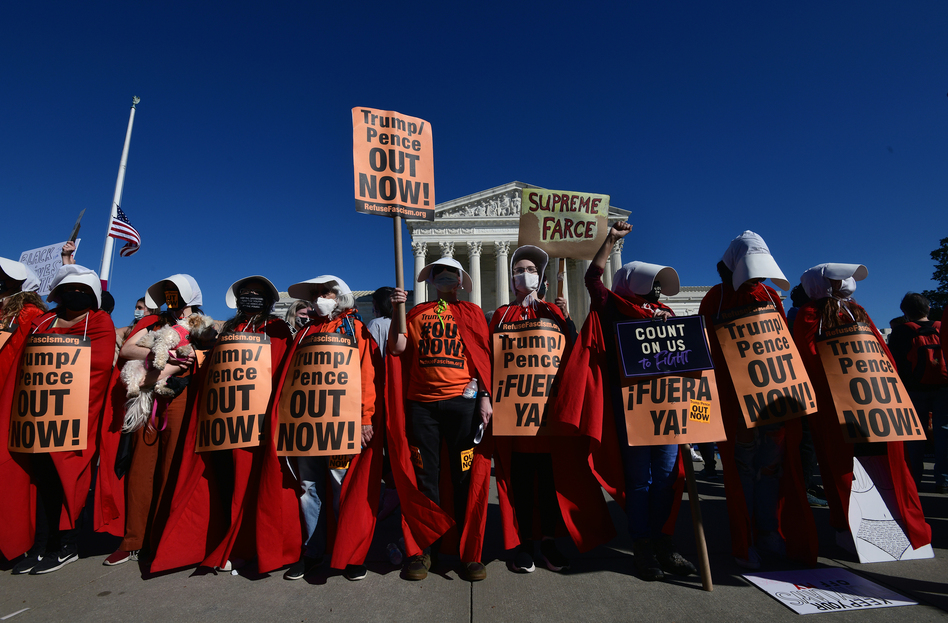 Women dressed as handmaidens to protest Supreme Court nominee Amy Coney Barrett.⁠⠀