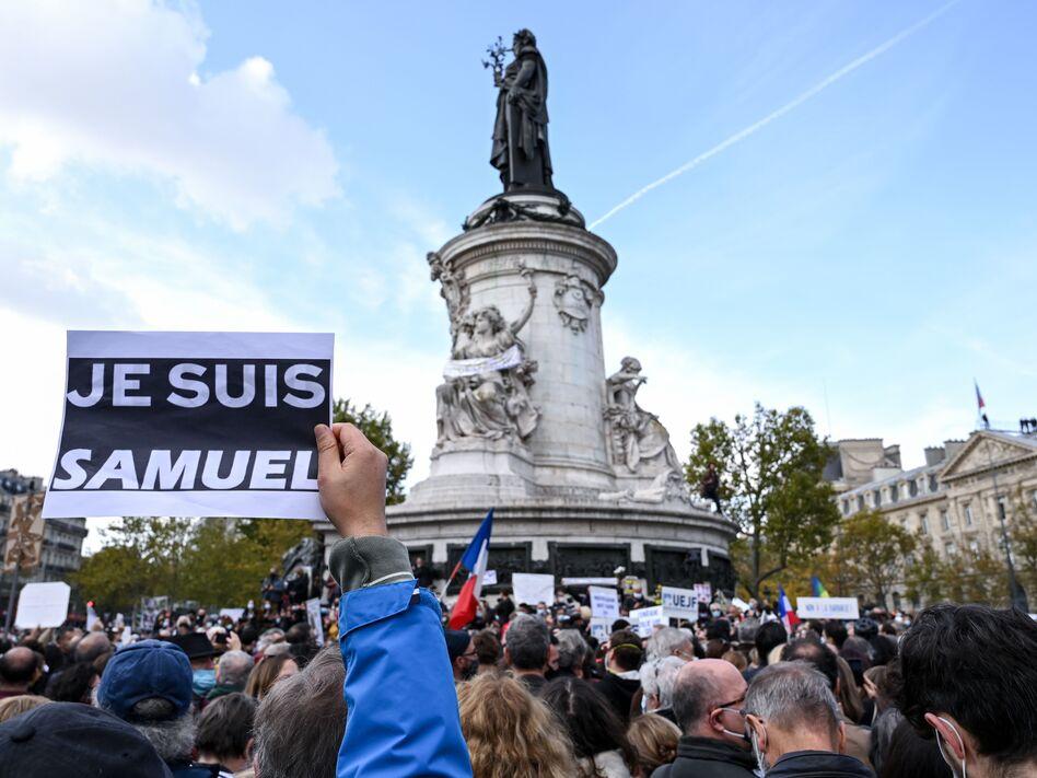 A demonstrator carries an