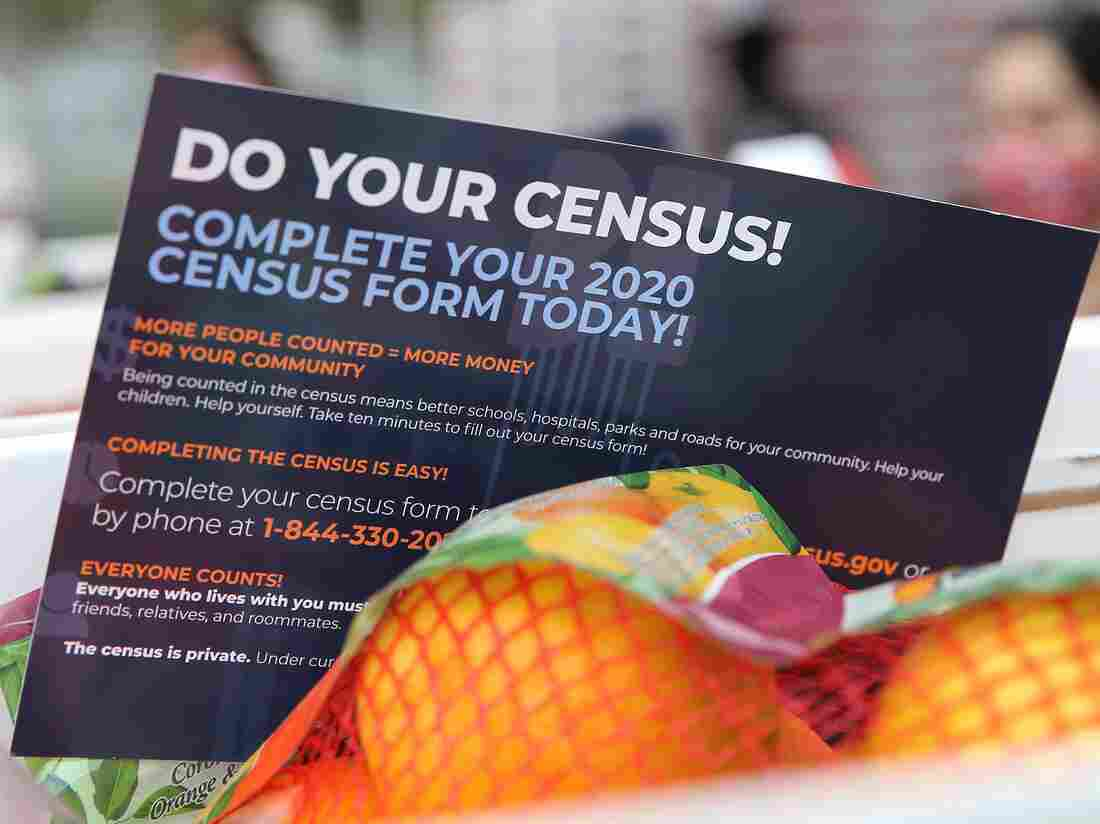 A pamphlet with 2020 census information is included in a box of food on in August, 2020 in Paramount, California.