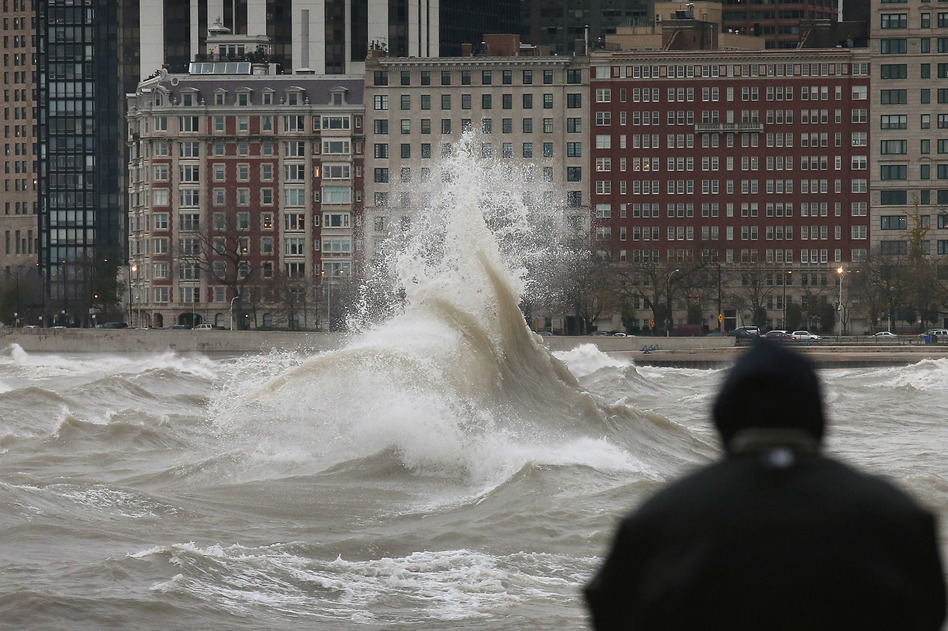 The remnants of Hurricane Sandy churn up Lake Michigan in Chicago in 2012. Flood risk in the city is increasing as climate change drives more extreme rain, and renters face greater financial peril than homeowners. More than half of Chicagoans are renters, according to 2019 census data. (Scott Olson/Getty Images)