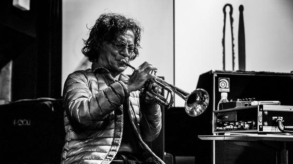 Esteemed jazz musician Toshinori Kondo playing the trumpet.