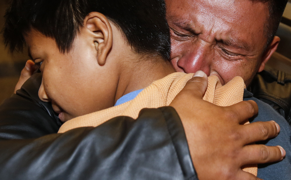"David Xol of Guatemala hugs his son Byron as they were reunited at Los Angeles International Airport in January. The father and son were separated 18 months earlier under the Trump administration's ""no tolerance"" migration policy."