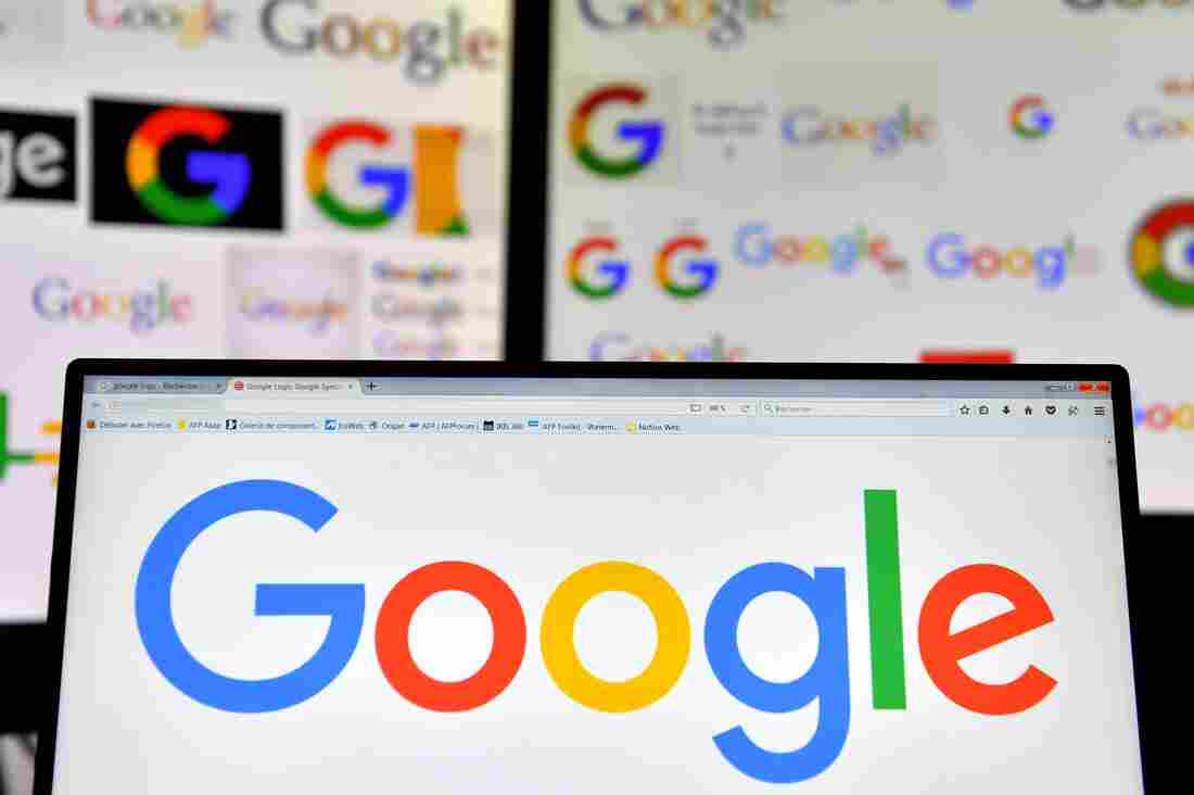 A picture taken on November 20, 2017 shows logos of US multinational technology company Google displayed on computers' screens.