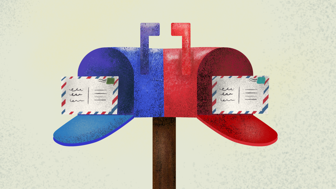 A blue and red mailbox with postcards inside