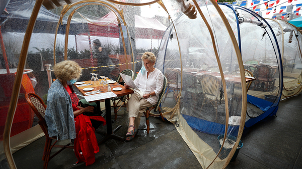 The latest pandemic dining twist is the outdoor bubble, seen here at a New York City restaurant. Sure, it