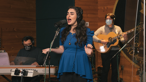 From left, Ron Adea (keyboards), Rawan Tuffaha (vocals) and Jackson D. Begley (guitar) perform during a virtual media appearance on Tue, Oct. 6, 2020 at Metalworks Studios in Mississauga, Ontario, Canada.