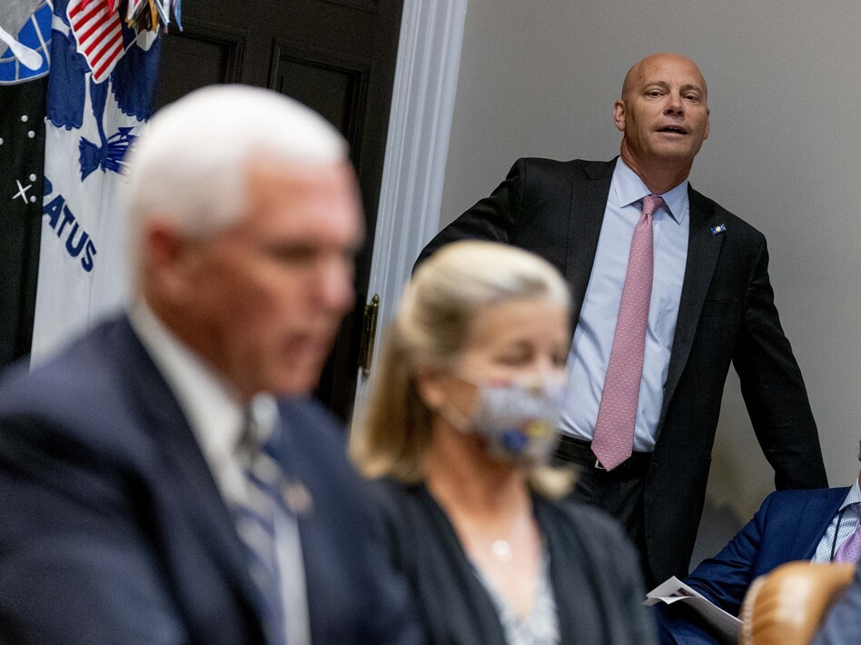 Marc Short, the chief of staff to Vice President Pence, listens to Pence speak during a White House event in September. Short tested positive for the coronavirus on Saturday. (Andrew Harnik/AP)