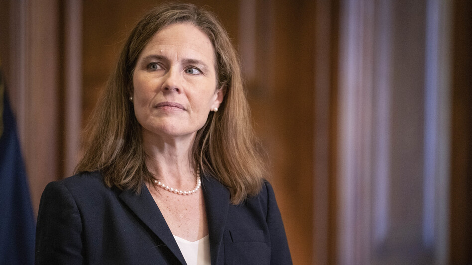 In a near-party-line vote Sunday, Senate Republicans advanced President Trump's Supreme Court nominee, Judge Amy Coney Barrett, seen here on Capitol Hill on Wednesday. A final confirmation vote is set for Monday evening. (Sarah Silbiger/Pool/Getty Images)