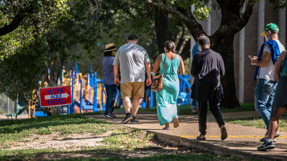 Voters approach a polling location in Austin, Texas, on Oct. 13 — the first day of voting in the state. Nearly 10 million ballots have already been cast in Texas — more than 2016's total votes in the state. (Sergio Flores/Getty Images)