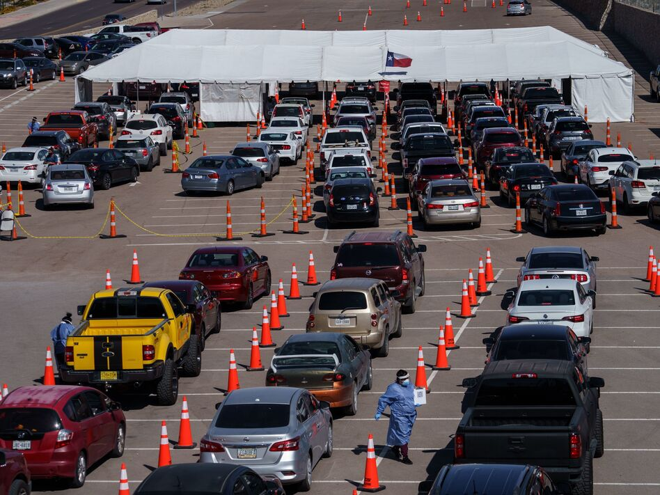 Cars line up Friday at a coronavirus testing site at the University of Texas at El Paso. The area has seen a surge in cases in recent weeks, and a two-week curfew is now in effect in El Paso County. (Paul Ratje/AFP via Getty Images)