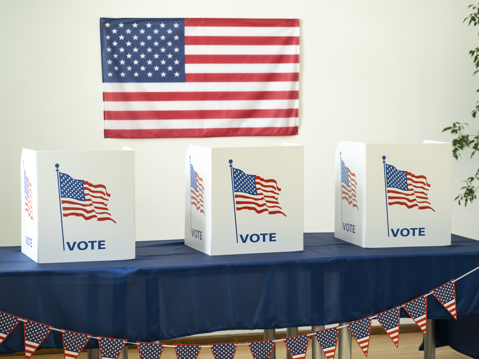 Uniformed police are generally not allowed around polling places, and the Pentagon doesn't want to get involved. Still, they're getting ready if things get out of control. (Vladimir Vladimirov/Getty Images)
