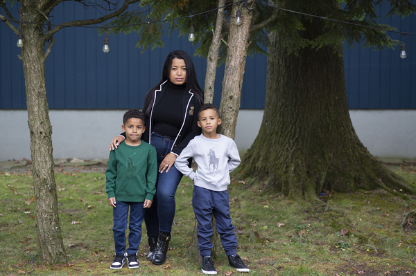 Farida Mercedes and her two sons Sebastian, 5, (left) and Lucas, 7, stand in their backyard in Fairlawn, N.J. Mercedes left her job as an assistant VP of HR at L'Oreal in August after working there for 17 years. As hundreds of thousands of women dropped out of the workforce in September, Latinas led the way, leaving at nearly three times the rate of white women.