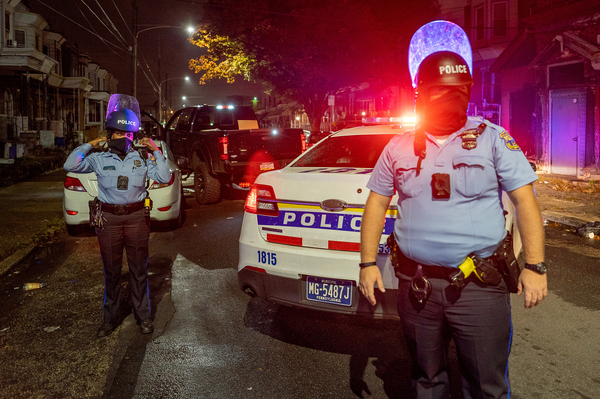 Police officers stand guard in Philadelphia following protests over the police shooting death of Walter Wallace on Tuesday.