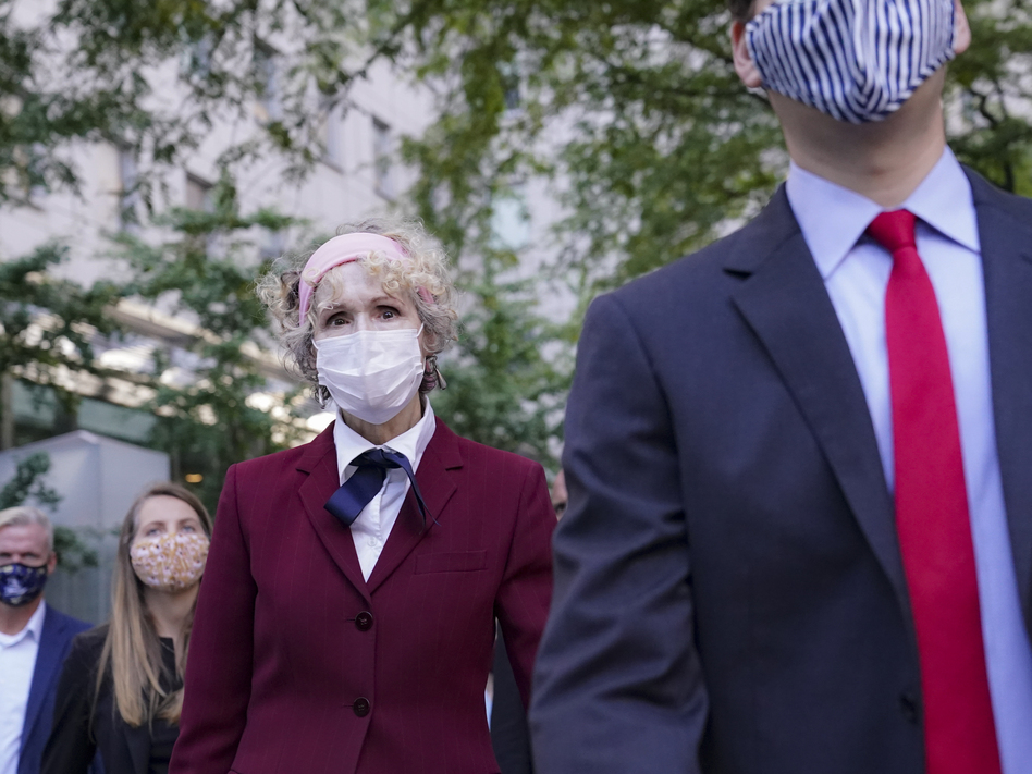 E. Jean Carroll (left), who has accused President Trump of raping her in the 1990s, leaves federal court in New York City after a hearing last week in her defamation lawsuit. (John Minchillo/AP)