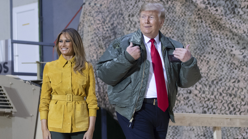 President Trump and first lady Melania Trump arrive to speak to members of the U.S. military during an unannounced trip to Al-Asad Air Base in Iraq in 2018. (Saul Loeb/AFP via Getty Images)