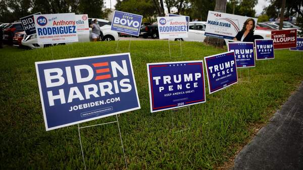 Campaign signs are seen at Westchester Regional Library in Miami on Oct. 19.