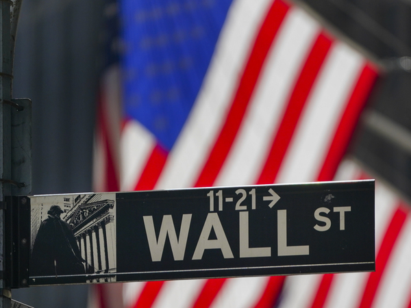 The U.S. flag hangs outside the New York Stock Exchange earlier this month. Investors have been grappling with a wave of uncertainty that's sent the market lower in recent weeks.
