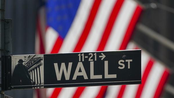 The U.S. flag hangs outside the New York Stock Exchange on Oct. 14, 2020, in New York. Stocks sank on Wednesday as rising coronavirus cases spooked investors.