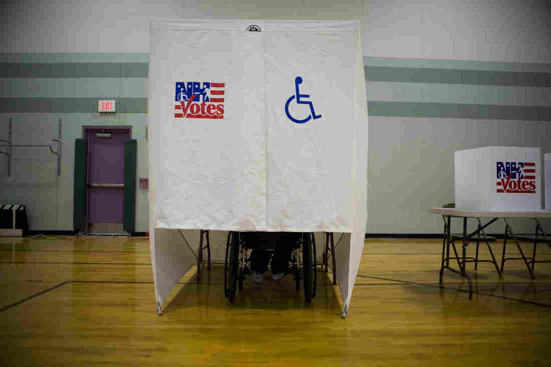 An accessible voting booth is seen during the New Hampshire primary at a high school in Nashua, N.H. If voting with a disability, plan ahead and know your rights. And don't leave that polling place without casting your ballot.