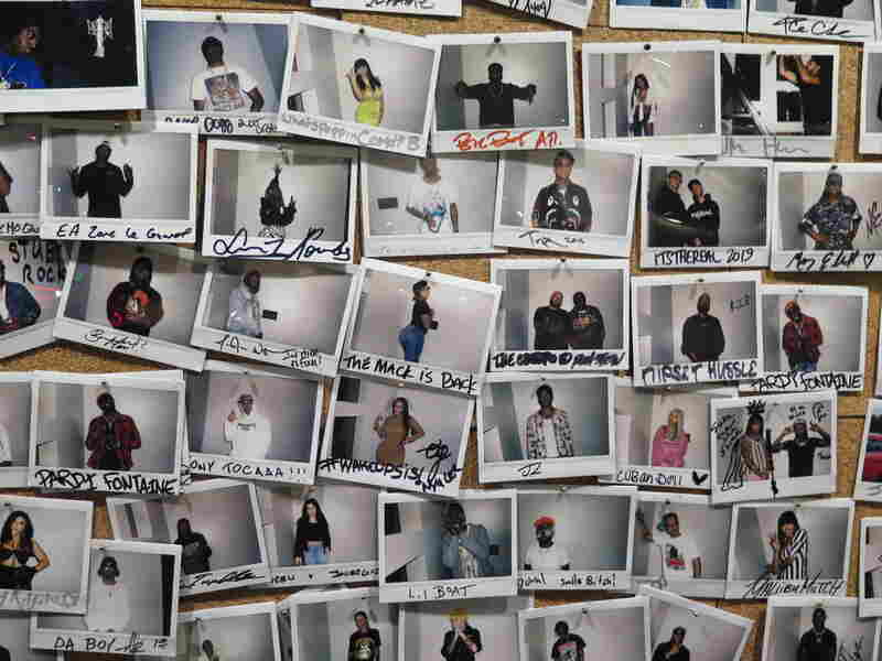 "Inside DJ Drama's Means St. Studio in Atlanta today, a ""wall of fame"" contains snapshots of artists who have passed through."