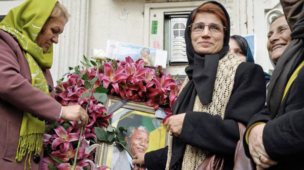 Iranian human rights lawyer Nasrin Sotoudeh with a poster of South Africa