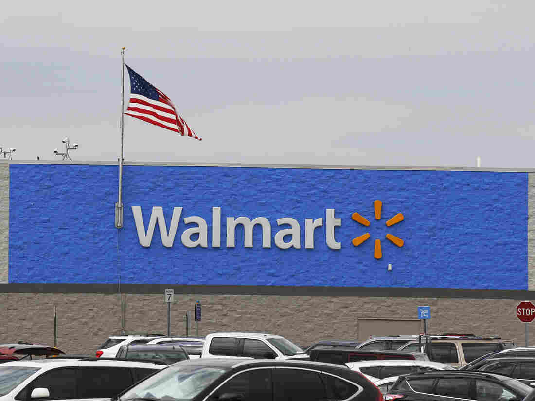 A U.S. flag waves over a Walmart parking lot in Oklahoma City on Aug. 4. The company sells firearms in about half of its 4,700 stores in the U.S