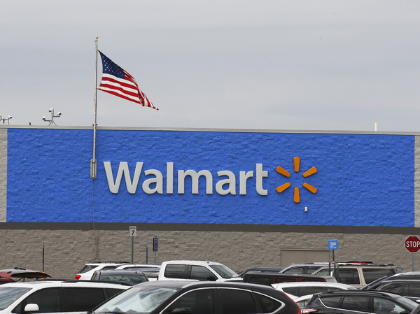 A U.S. flag waves over a Walmart parking lot in August in Oklahoma City. The company sells firearms in about half of its 4,700 stores in the United States.