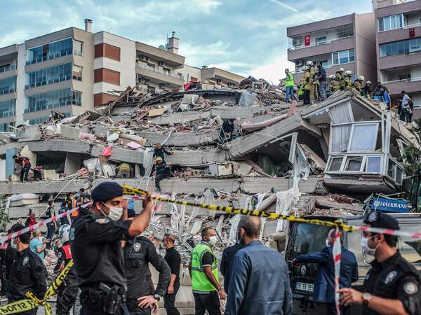 Rescuers search for survivors Friday in a collapsed building in Izmir, Turkey, after a powerful earthquake struck Turkey's western coast and parts of Greece.