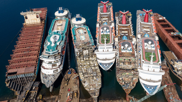 In this aerial view, five luxury cruise ships are seen being broken down for scrap metal in Izmir, Turkey. With the global coronavirus pandemic pushing the cruise industry into crisis, some cruise operators have been forced to cut losses and retire ships. The cruise industry has been one of the hardest hit industries after a series of outbreaks occurred on cruise liners as the pandemic spread.