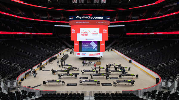 Voting trainers prepare to instruct poll workers in preparation for early voting at Capital One Arena in Washington, D.C., on Oct. 19.