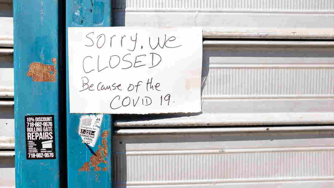 Brooklyn, NY - 26 March 2020. Residents of New York City have been asked to stay home as a result of the novel coronavirus, and all but essential businesses have been asked to close. A sign on a closed laundromat on Avenue J.