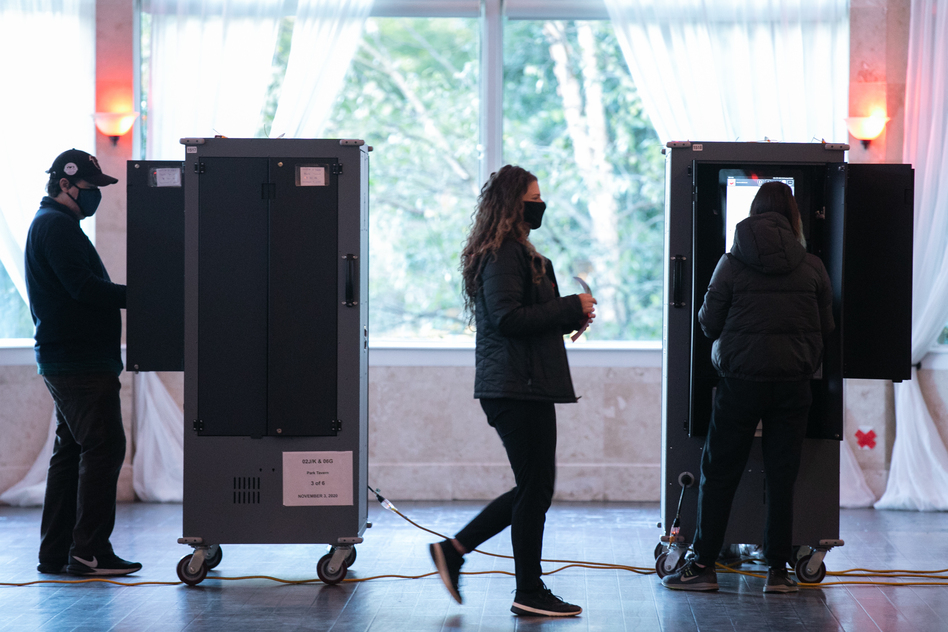 Voters cast ballots Tuesday at the Park Tavern polling station in Atlanta. (Jessica McGowan/Getty Images)