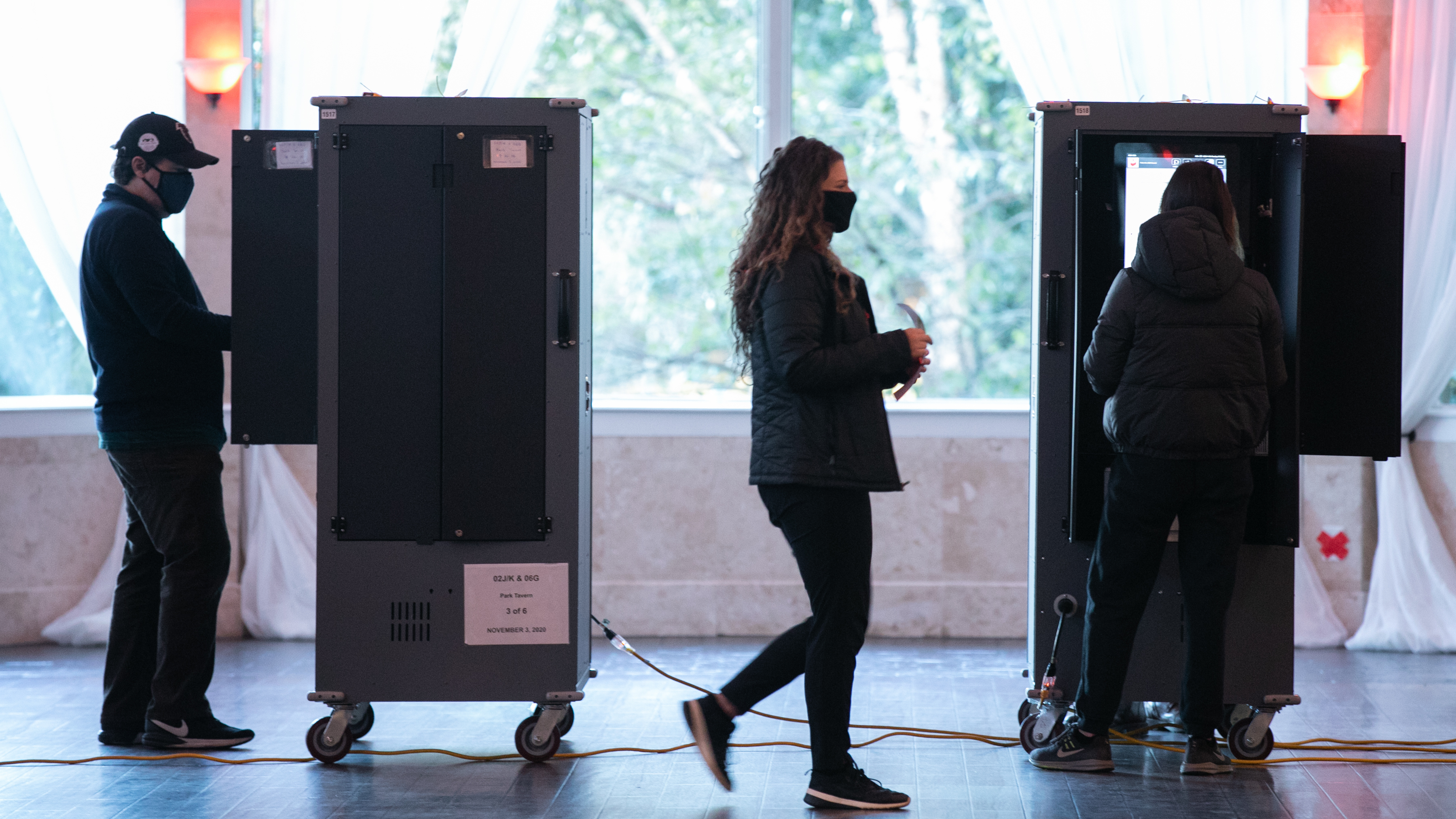 Voters cast ballots Tuesday at the Park Tavern polling station in Atlanta.