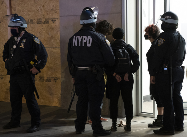 Police officers arrest some protesters in New York City on Wednesday. The department said there were 25 arrests.