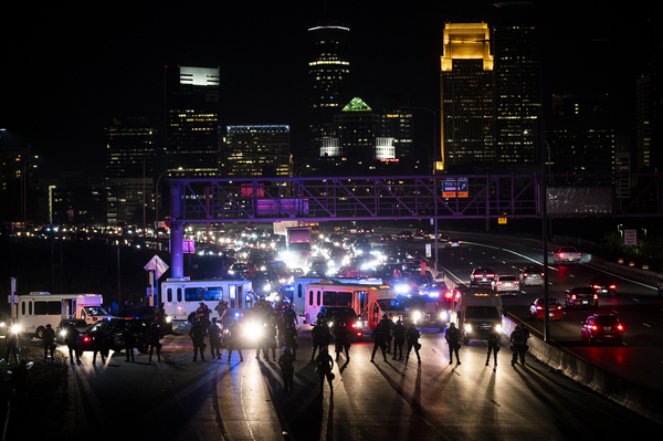 Police block traffic as demonstrators march on to highway I-94 on Wednesday in Minneapolis.