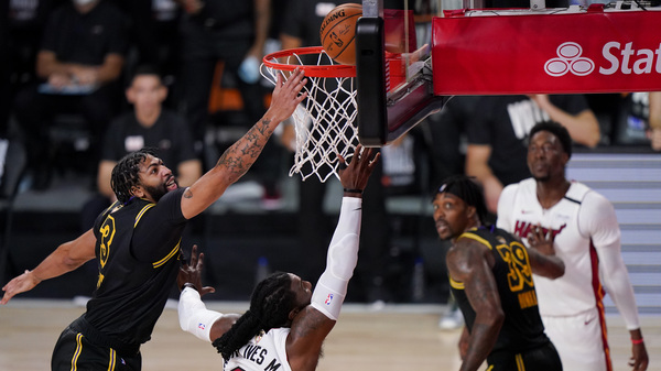 Los Angeles Lakers forward Anthony Davis vies for a rebound with Miami Heat forward Jae Crowder during Game 5 of the NBA Finals Friday last month in Lake Buena Vista, Fla.