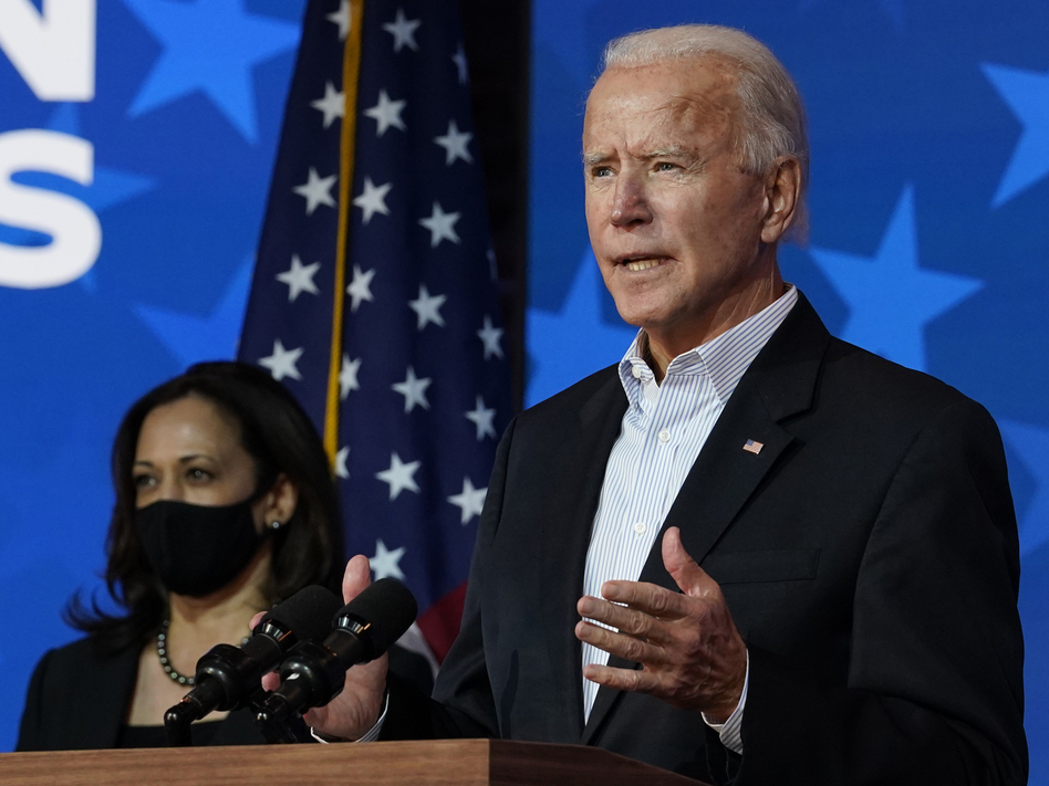 President-elect Joe Biden, flanked by Vice President-elect Kamala Harris, is likely to face a divided Congress. That's something he'll need to consider as he sorts through which parts of his agenda to push first. (Carolyn Kaster/AP)