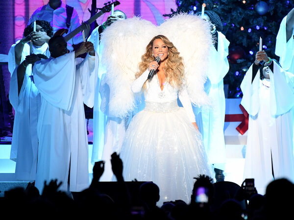 Mariah Carey performs onstage during her